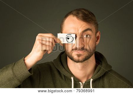 Silly man looking with hand drawn eye balls on paper