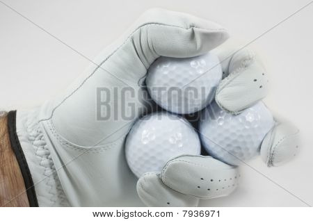 Golf Balls In Fist