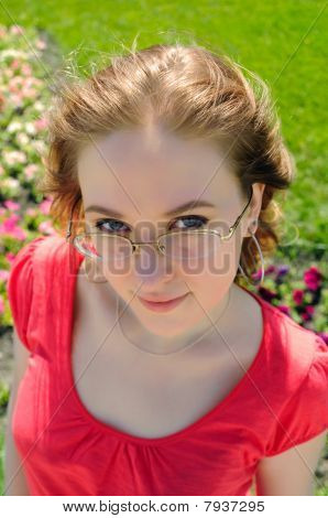 The Woman Looking Atop Of Glasses