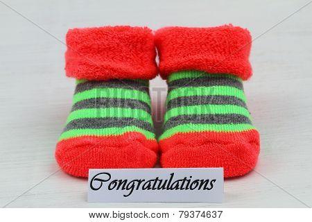 Congratulations card with stripy baby socks