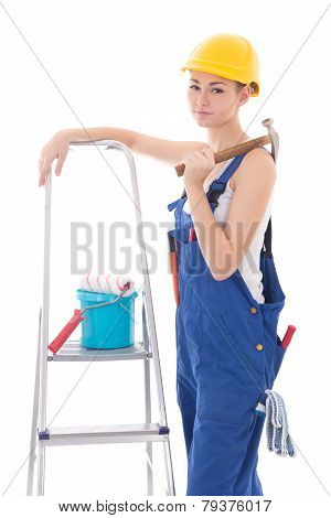 Young Beautiful Woman In Blue Coveralls With Builder's Tools And Ladder Isolated On White