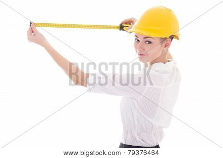 Business Woman Architect In Yellow Builder Helmet Measuring Something With Measure Tape Isolated On