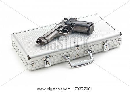 the handgun on aluminium case