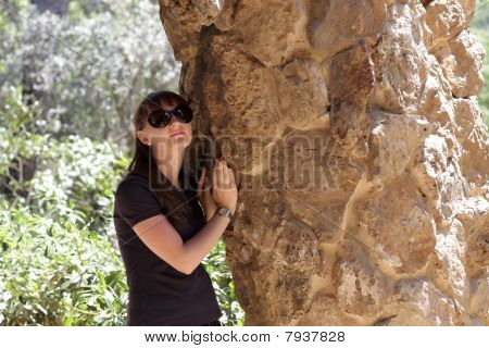 Girl Rests With Rock Pillar At Park Güell
