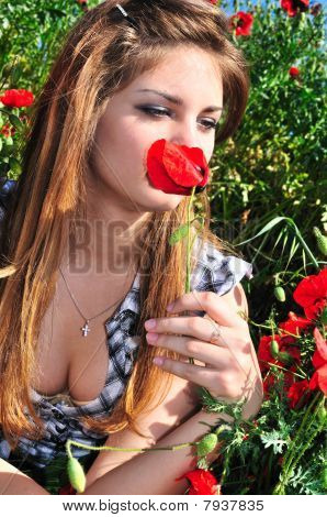 Girl Smelling Poppy