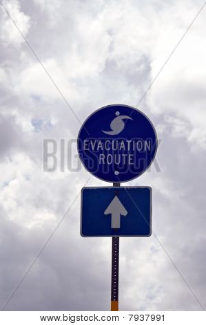 Evacuation Route Sign In Florida Against Storm Clouds