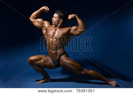 Strong Muscular Man Bodybuilder Shows His Muscles.