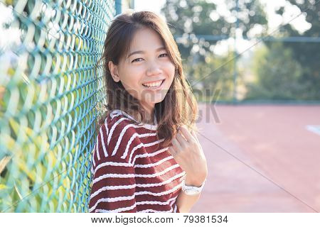 Portrait Of Beautiful Young Woman Toothy Smiling With Happy Face With Evening High Light On Hair Use