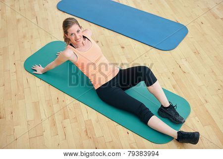 Fit Woman Exercising At Gym