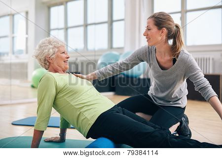 Physical Therapist Working With A Senior Woman At Rehab