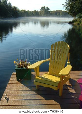 Yellow Muskoka Chair on the Dock at the Lake