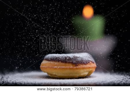 Sprinkling Sugar On Delicious Donut