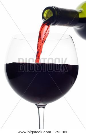 Red wine pouring down from a wine bottle (clipping path included)