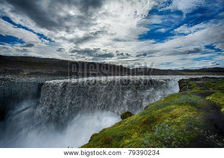 Dettifoss is the most powerful waterfall on Iceland and in the whole Europe. It is located in Jokulsargljufur National Park the northeasten Iceland on the river Jokulsa a Fjollum.