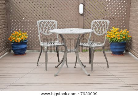 Bistro Table and Chairs on a Deck