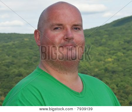 Overweight Male After Hike Up A Forest Mountain