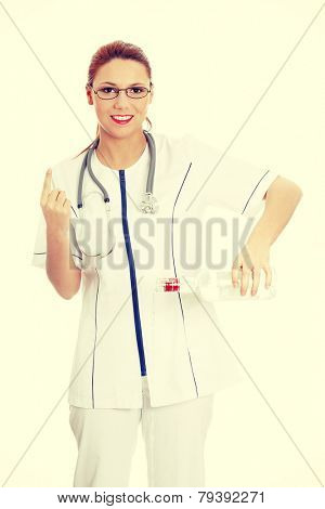 Female doctor pouring vodka bottle, and gesturing NO with finger.