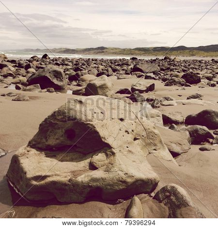 Rocks on sand, Raglan, New Zealand