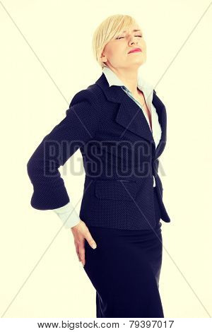Mature business woman with backpain.