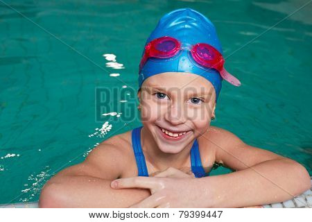 Happy Kid Laughing In A Swimming Pool.