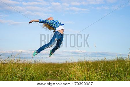 Professional gymnast woman jump in green grass field