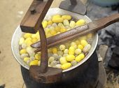 stock photo of cocoon  - Boiling cocoon in a pot to prepare a cocoon silk - JPG
