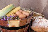 stock photo of maize  - Wooden basket with flowers - JPG