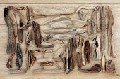 stock photo of driftwood  - Driftwood selection over old oak wood background - JPG