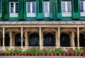 stock photo of nepali  - King palace museum with picture gallery green windows and flower pots on Durbar square in Kathmandu Nepal - JPG