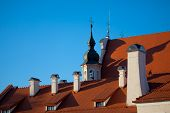 stock photo of red roof tile  - Red tile roof of a catholic church in Vilnius old town Lithuania - JPG
