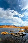 picture of steppes  - steppe landscape with mountains and the lake - JPG