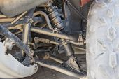 pic of chassis  - Closeup detail of chassis and steering with suspension on ATV quad bike - JPG