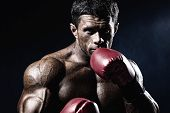 image of angry man  - Strong muscular boxer in red boxing gloves - JPG