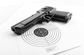 picture of pistols  - Paper target and pistol - JPG