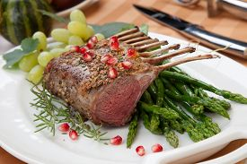 picture of crust  - Herb crusted rack of lamb garnished with asparagus green grapes and pomegranates - JPG