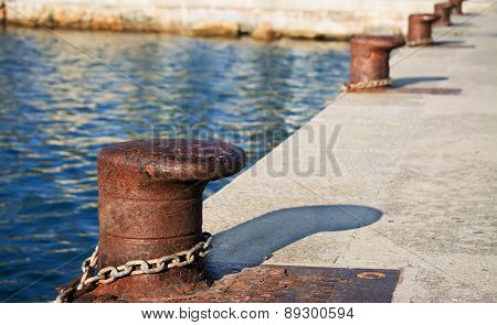 Metal Bollards On The Dock