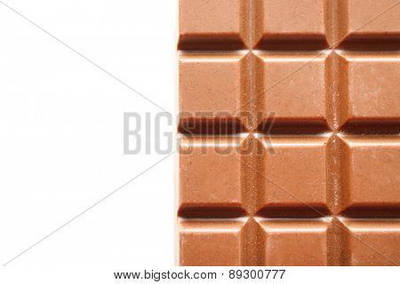 Milk chocolate bar isolated on white