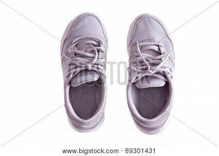 Pair Of Worn White Sneakers On White Background