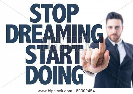 Business man pointing the text: Stop Dreaming Start Doing