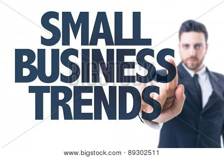 Business man pointing the text: Small Business Trends