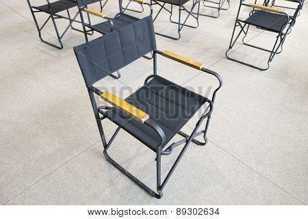 Empty Black Folding Chairs