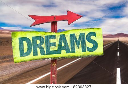 Dreams sign with road background