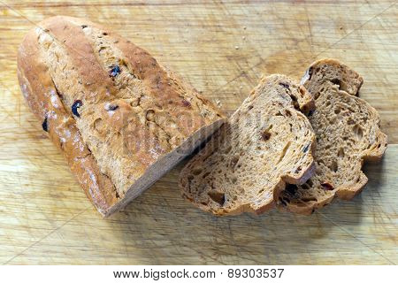 Mediterranean Sun Dried Tomato Bread On A Chopping Board