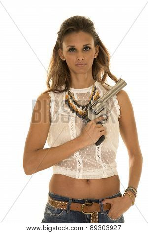 Cowgirl In White Top With Revolver Across Chest