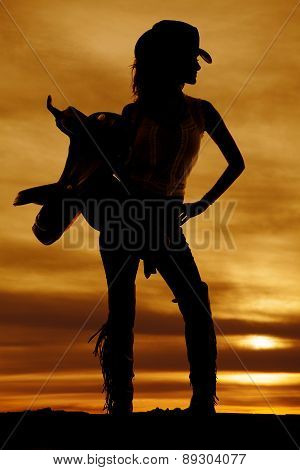 Silhouette Of A Cowgirl Hold Saddle On Shoulder Look To Side