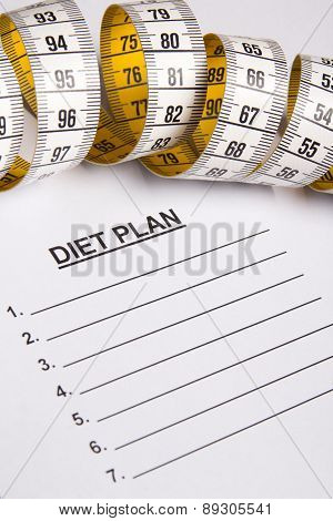 Measure Tape On Paper With Diet Plan
