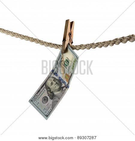 Dollar Bill Is Hanging On A Rope With Wooden Clothespin Isolated On White.