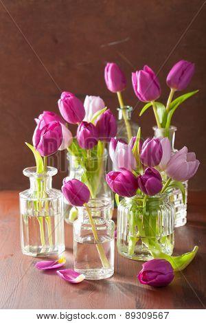beautiful purple tulip flowers bouquet in vases