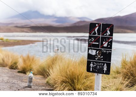 warning sign at a lagoon in bolivia