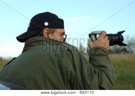 Man With A Photocamera